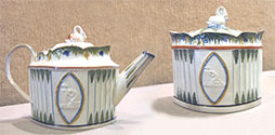 Teapot and Sugar Bowl. Pearlware with molded body painted in underglaze green and ochre in Pratt-type decoration. Staffordshire, c. 1790-1800