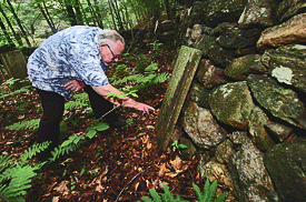 Richard Roberts inspects the headstone on Seth Smith's grave, courtesy Stamford Times, click for more